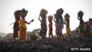 Women scavenge coal from an open-cast mine in the village of Jina Gora, near Jharia, in Jharkhand state - 11 February 2012