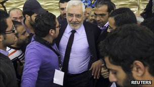 Abdel Moneim Aboul Fotouh surrounded by young supporters at a campaign rally