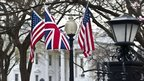 Union Jack and Stars and Stripes fly in front of the White House in Washington on 12 March 2012