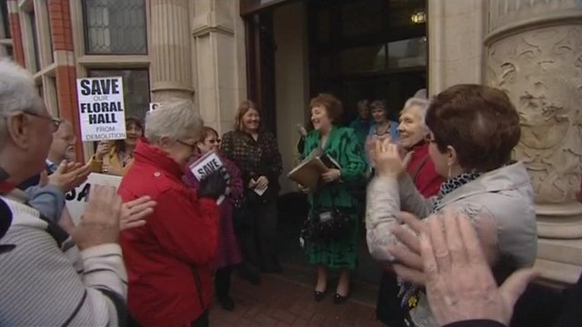 Campaigners celebrate after the council meeting