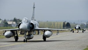 Two French Dassault Mirage 2000-5 aircraft prepare for take off from Dijon military base on a mission to Libya (19 March 2011)