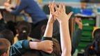 Hand raised in classroom