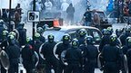Riot police face a mob in Hackney, north London on 8 August, 2011