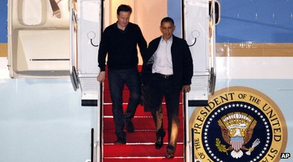 US President Barack Obama and British Prime Minister David Cameron walking off Air Force One