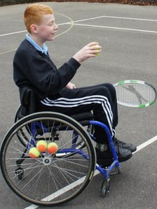 School Reporter Charlie in action on the tennis court