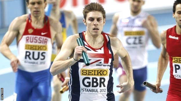 Richard Buck (centre) wins silver in the men's 4x400m relay at the 2012 World Indoor Championships