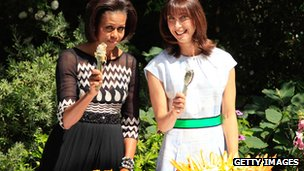 Michelle Obama and Samantha Cameron serve food in the Downing Street garden in 2011