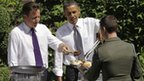 Barack Obama and David Cameron serve burgers in the Downing Street garden in 2011