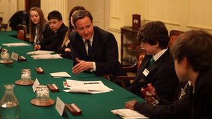 Prime Minister, David Cameron, and School Reporters gather around the table in The Cabinet Room, to discuss gang-crime, unemployment and Angry Birds