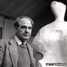 Henry Moore standing by one of his sculptures in 1960