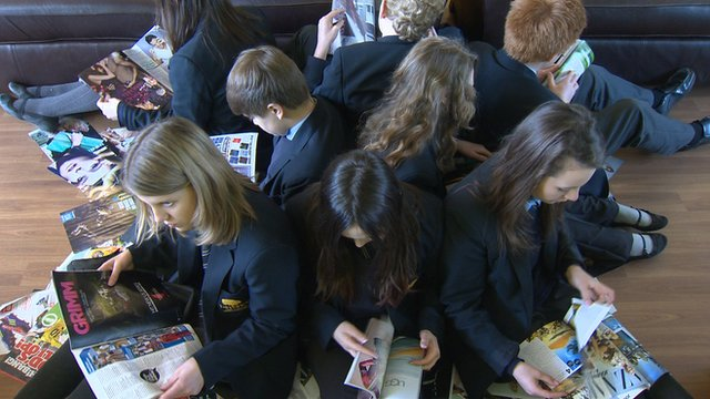 Pupils reading glossy magazines