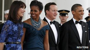 US President Barack Obama and first lady, Michelle, pose for photographs with UK Prime Minster David Cameron and wife Samantha, ahead of a White House state dinner.