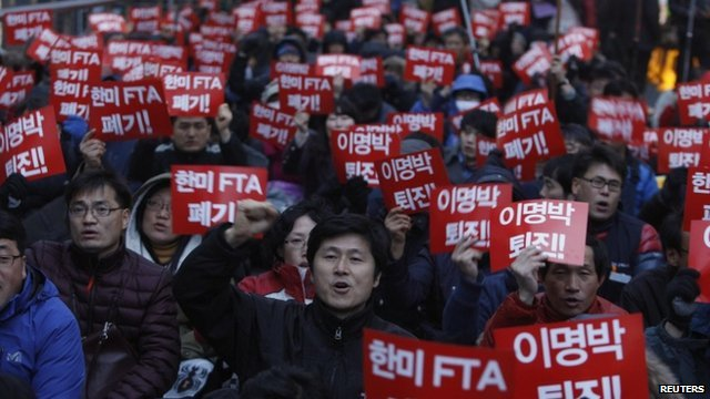 Protesters at a rally against the free trade agreement in Seoul