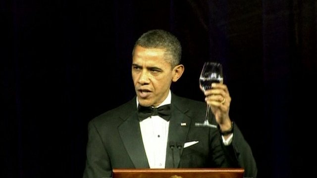 President Barack Obama raises a glass to the Queen.