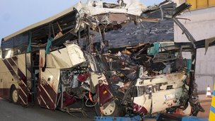The wreckage of the Belgian bus