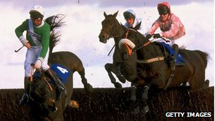 Tree Creaper ridden by Luke Harvey falls over a jump during a race at Newbury