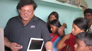 Professor Mitra installs computer