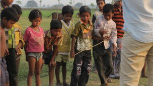 Children line up to play the game Danda Gilli