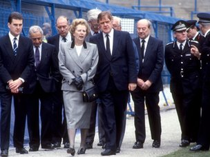 Margaret Thatcher walks with Bernard Ingham, Douglas Hurd, Bert Millichip and others as they see the scene of the Hillsborough Disaster, at Hillsborough Stadium, Sheffield. April 16 1989