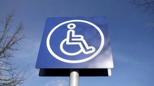 Sign above disabled parking bay
