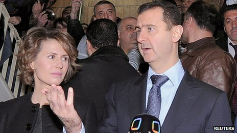 Mr and Mrs Assad on referendum day in March 2012