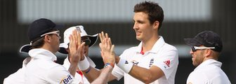 Steven Finn (centre) is congratulated after taking a wicket in England's first warm-up game