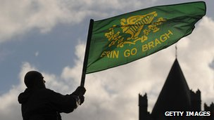 Man waving flag with Irish sentiment
