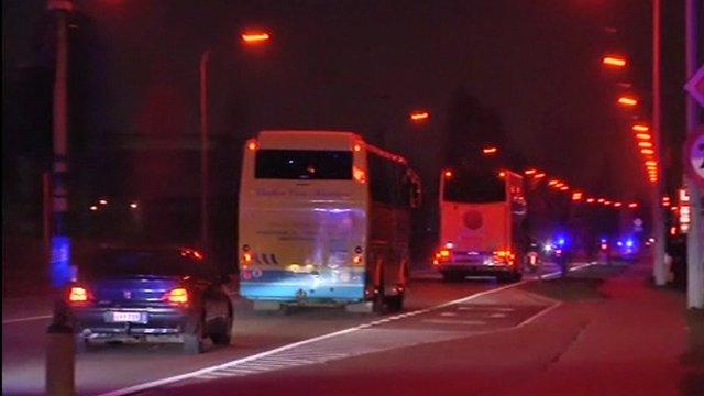 Convoy of coaches carries crash survivors home to Belgium.
