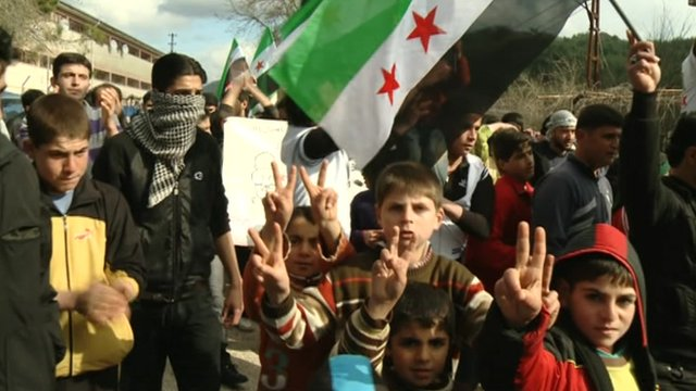 Refugees from Syria in Turkey make victory signs.
