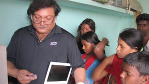 Professor Mitra installs a computer in a village in India