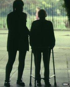 Elderly man with carer
