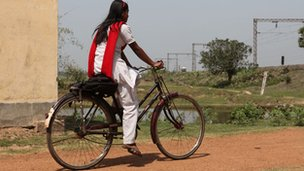 Many girls like Parveen travel to school by bike in rural India