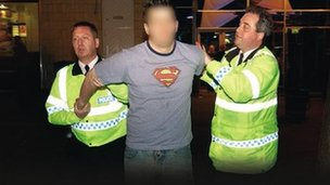 A man being arrested by police