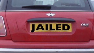 A picture of a number plate with letters spelling the word jailed.