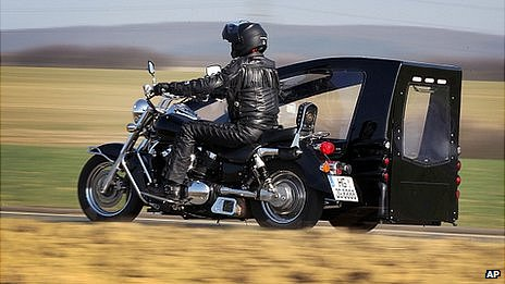 Joerg Grossmann rides his Kawasaki VN 1500 fitted with a sidecar hearse