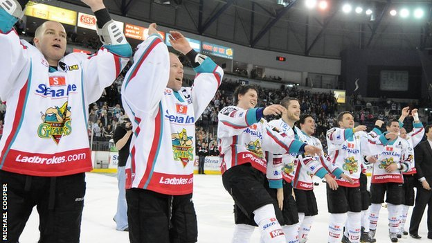 Giants players celebrate with fans after winning the Elite League title