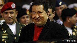 Venezuela's Chavez flies home after cancer treatment
