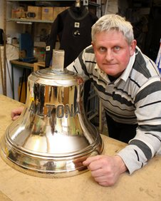 Simon Rodger with the ship's bell