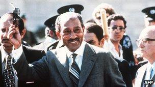Egyptian President Anwar Sadat waves during his historic visit to Israel, 19 November 1977