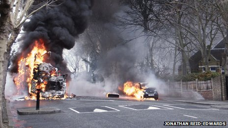 A bus and car on fire