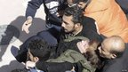 Woman is carried away after fainting as she mourns for Pope Shenouda - 18 March