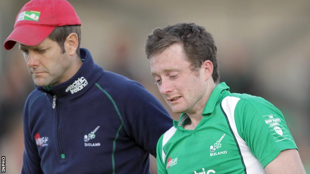 Ireland coach Paul Revington consoles player John Jackson after the final whistle