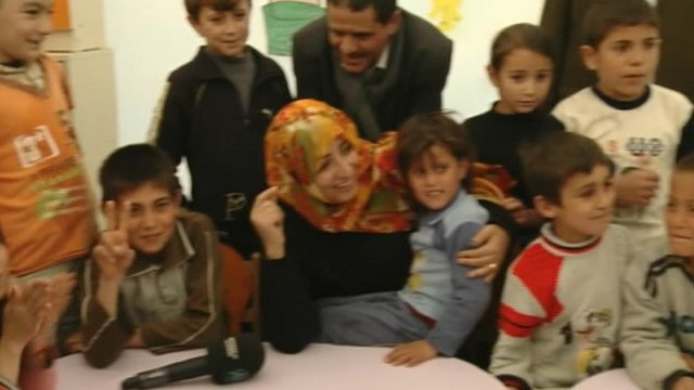 Tawakul Karman with Syrian refugees