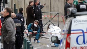 Police investigators at the scene of the shooting outside Ozar Hatorah school, in Toulouse, France, on 19 Marc 2012