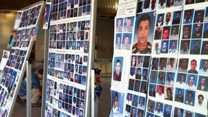 Three boards of photographs showing missing Libyans