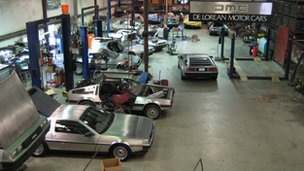 DeLorean Motor Company workshop with DMC-12s in various states of repair