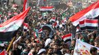 Thousands of supporters of the Sadrist movement wave the Iraqi flag