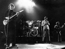 Wilko Johnson (left) performing with Dr Feelgood, December 1976
