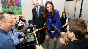 Richard and Joshua Margereson (left) enjoy music with the Duchess of Cambridge at EACH, Ipswich