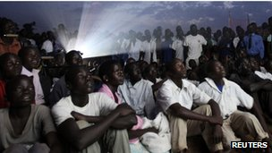 "Residents watch the premiere of ""Kony 2012"", a 30-minute YouTube film created by the nonprofit group Invisible Children, in Lira district located 376 km (234 miles) north of Uganda""s capital Kampala March 13, 2012."